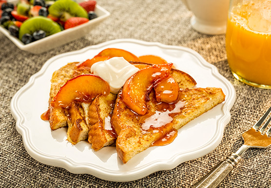Parker County Peach French Toast served on a white plate on a kitchen table