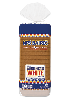 A bag containing a loaf of Mrs Baird's Made with Whole Grain White bread